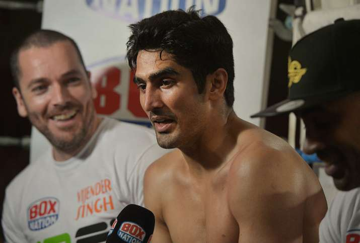 Vijender Singh speaks during a media conference