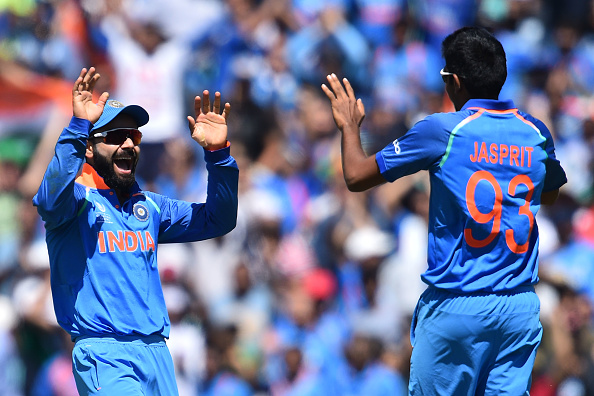 Virat Kohli celebrates with Jasprit Bumrah