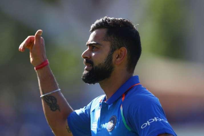 Virat Kohli of India celebrates as he leaves the field