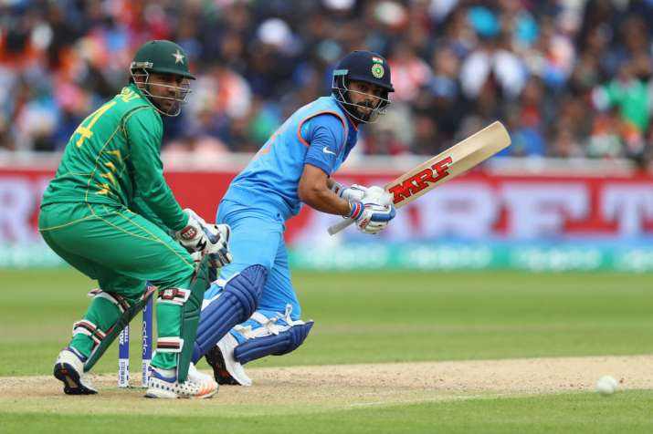 Virat Kohli of India plays a shot behind point