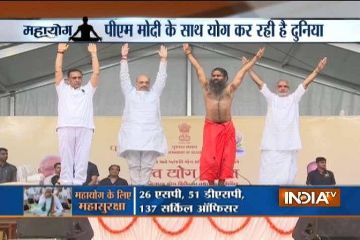 India Tv - Vijay Rupani, Amit Shah and Baba Ramdev in a Yoga camp in Ahmedabad