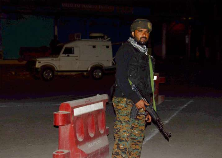 Security person stand guard after militants opened fire on
