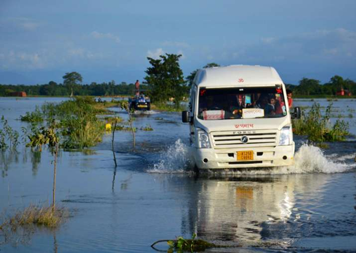 People travel in a mini bus at flood-hit Jamlai village in