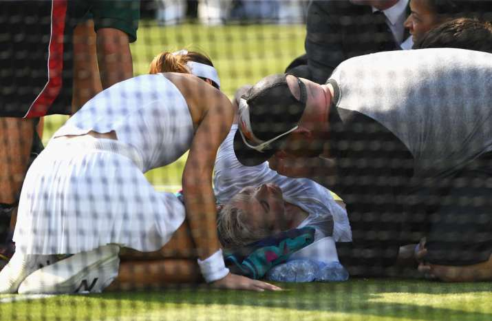 Bethanie Mattek-Sands of USA receives treatment from the