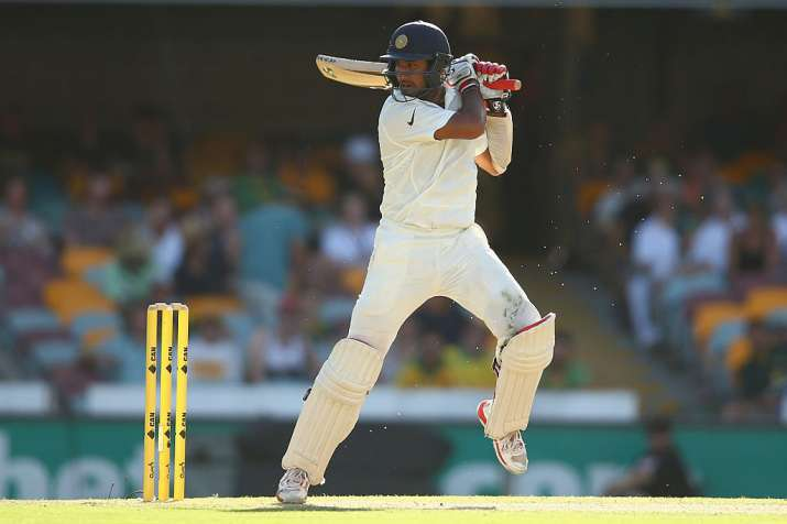 Cheteshwar Pujara of India plays a shot