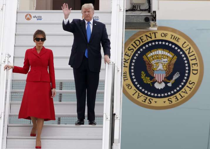 Donald Trump and FirstLady Melania arrive at Orly airport