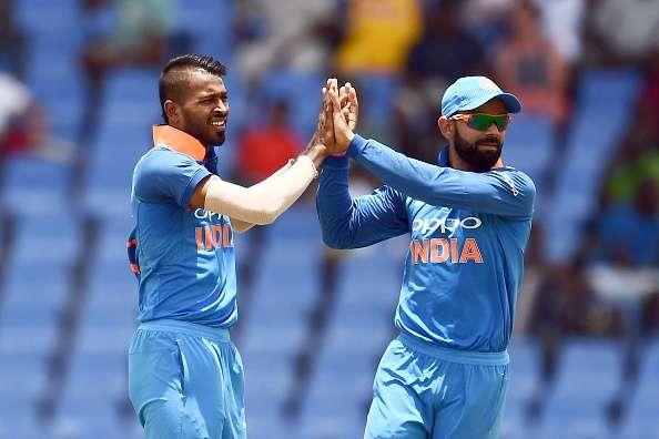 Hardik Pandya celebrates with team captain Virat Kohli