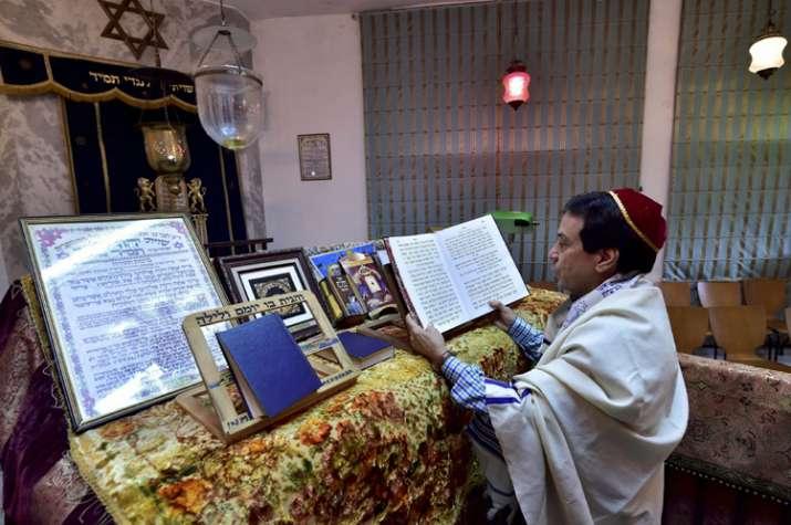 Priest Ezekiel Markel reads religious books at Judah Hyam