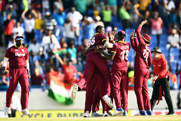 Jason Holder celebrates with teammates after defeating