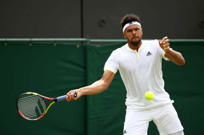 Jo-Wilfried Tsonga of France plays a forehand