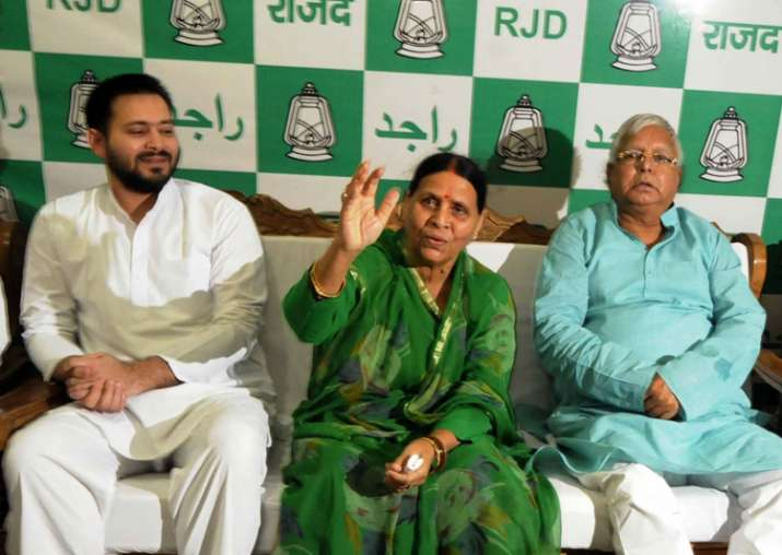 File pic - Lalu, Rabri and Tejashwi during a party