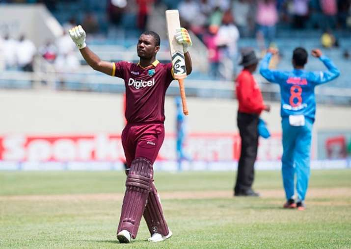 Evin Lewis reacts after reaching to his hundred.