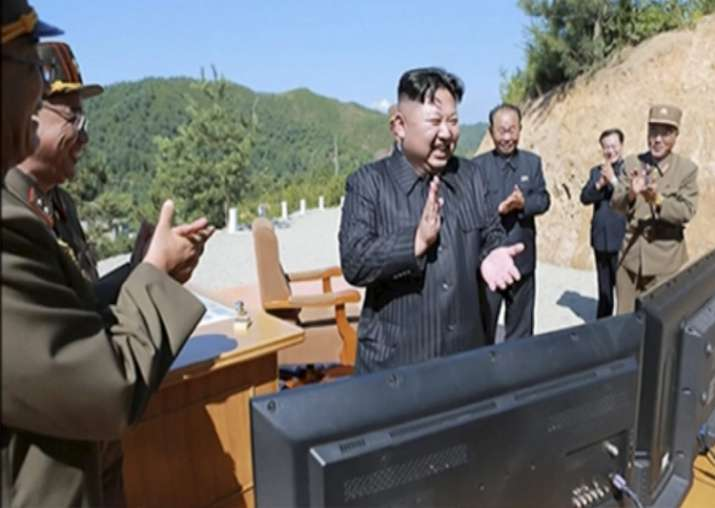 File pic -Kim Jung Un applauding after intercontinental