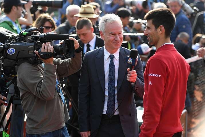 Novak Djokovic of Serbia is interviewed by John McEnroe