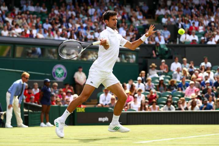 Novak Djokovic of Serbia plays a forehand during the first