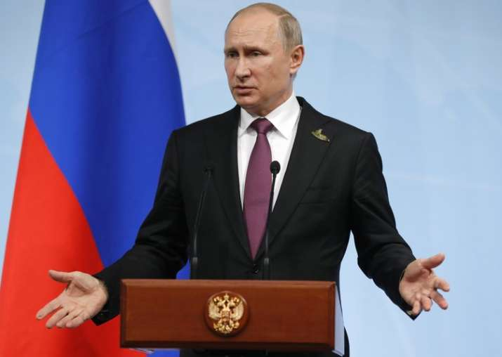 Putin gestures during a press conference after G20 Summit