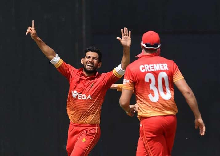 Sikander Raza celebrates a wicket.