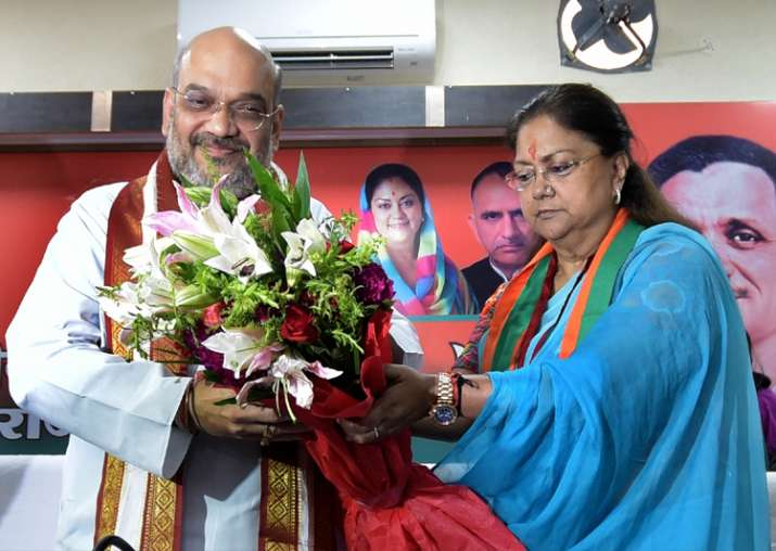 Amit Shah being felicitated by CM Raje during a party
