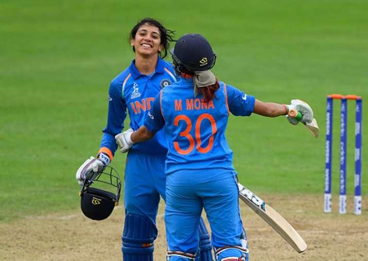 Smriti Mandhana celebrates her century against West Indies.