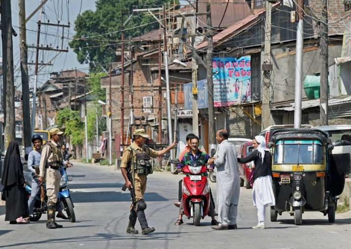 Security jawans checking during restrictions in Srinagar on