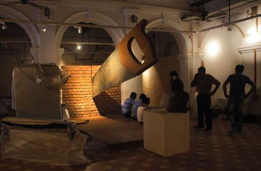 India Tv - giant saw installation that is cutting through a brick wall at Partition Museum