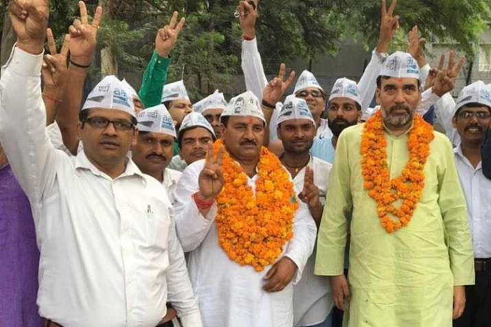 File Photo - AAP candidate Ram Chander in the middle