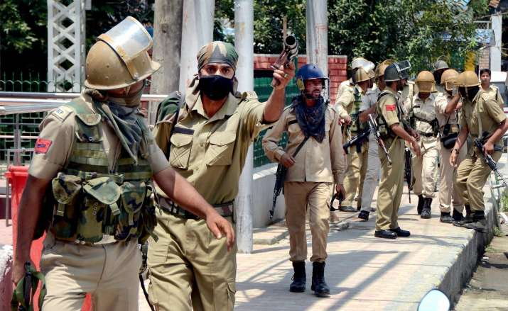 India Tv - Police during protest in Srinagar by students following the killing of Dhujana