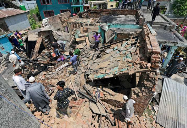 India Tv - House destroyed during encounter between forces and militants in Pulwama