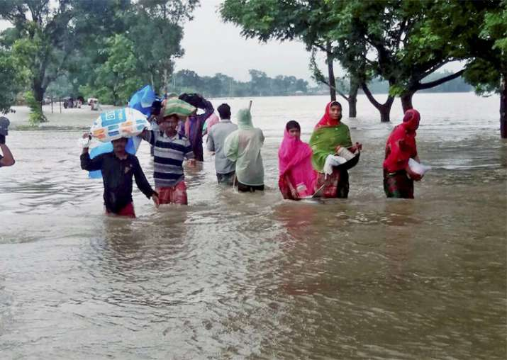 Villagers wade through flood waters in Kishanganj district