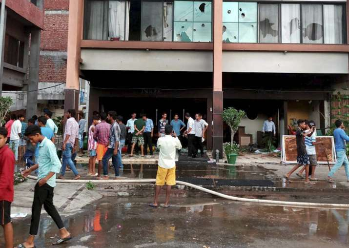 File pic - Supporters of Dera Sacha Sauda set ablaze shops