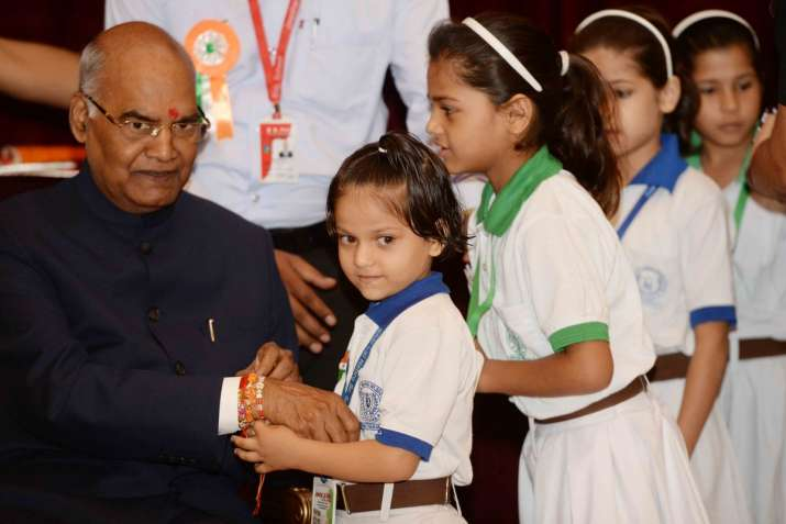 India Tv - A schoolchild greeting President Kovind on Raksha Bandhan