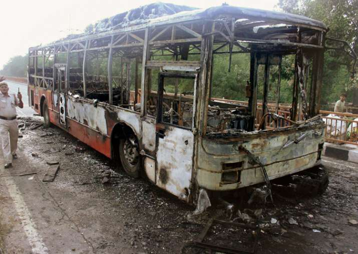 New Delhi: A DTC bus set on fire by followers Gurmeet Ram