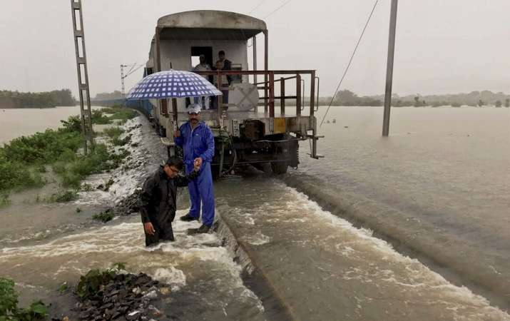 A goods train halts on the flooded tracks in Bihar's Katihar