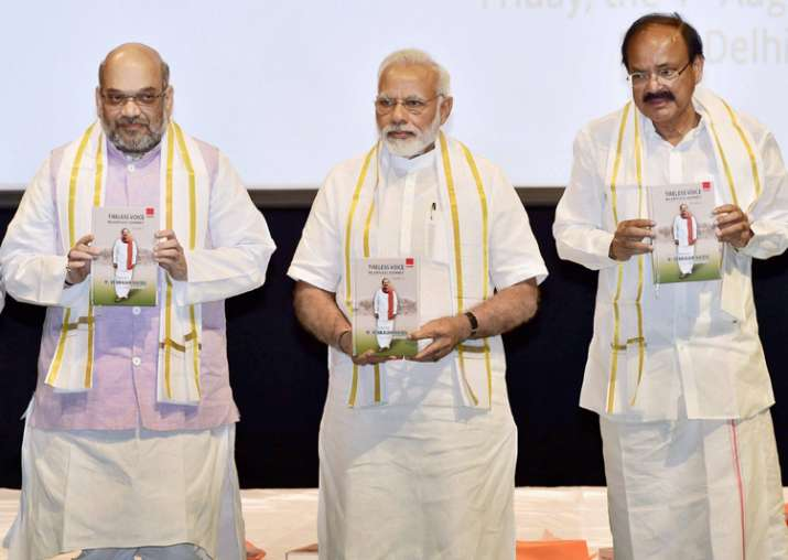 Amit Shah, PM Modi and Venkaiah Naidu at an event in New
