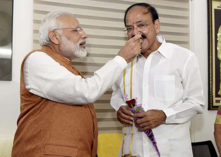 PM Modi offers sweets to VP-elect Venkaiah Naidu at his