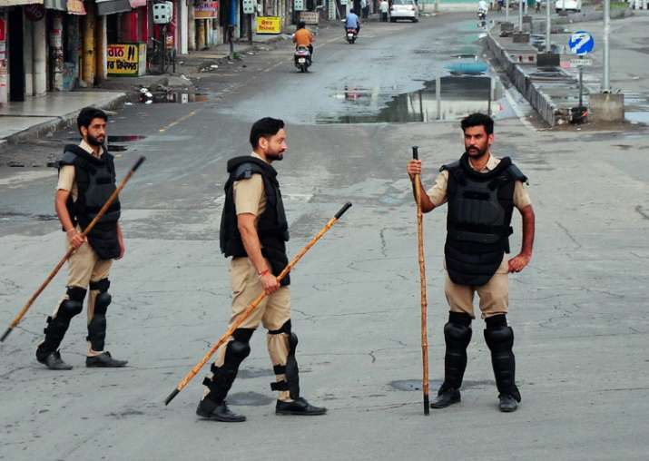 File pic: Security personnel keep vigil in a street in