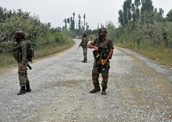Pulwama: Army personnel stand guard during a gun battle