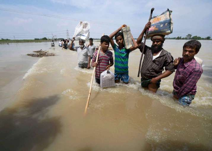 India Tv - Purnea: Flood-affected villagers shift with their belongings