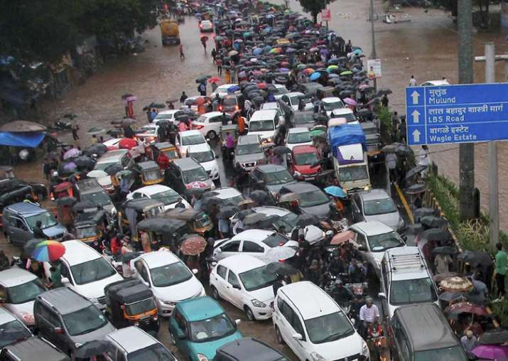 Vehicles stuck at a flooded street after heavy rains in