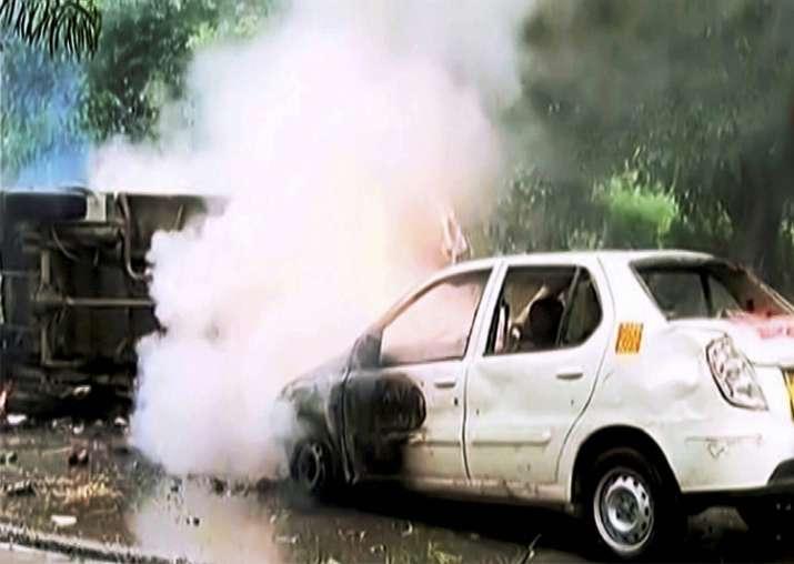 Panchkula: A vehicle burns during arson following Ram
