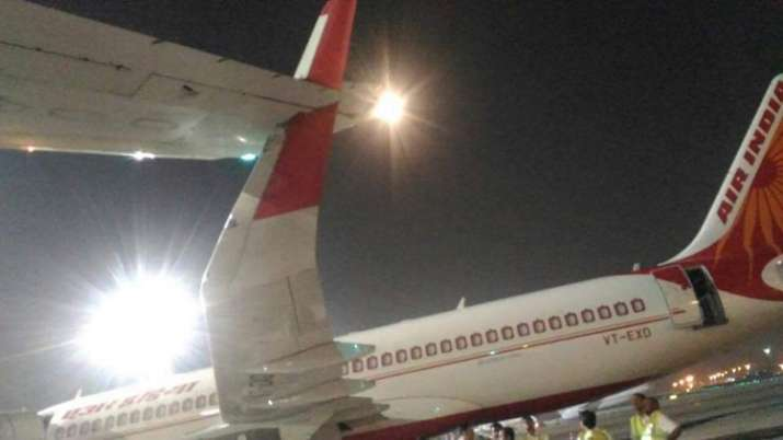 India Tv - Wings of two planes collided at IGI airport