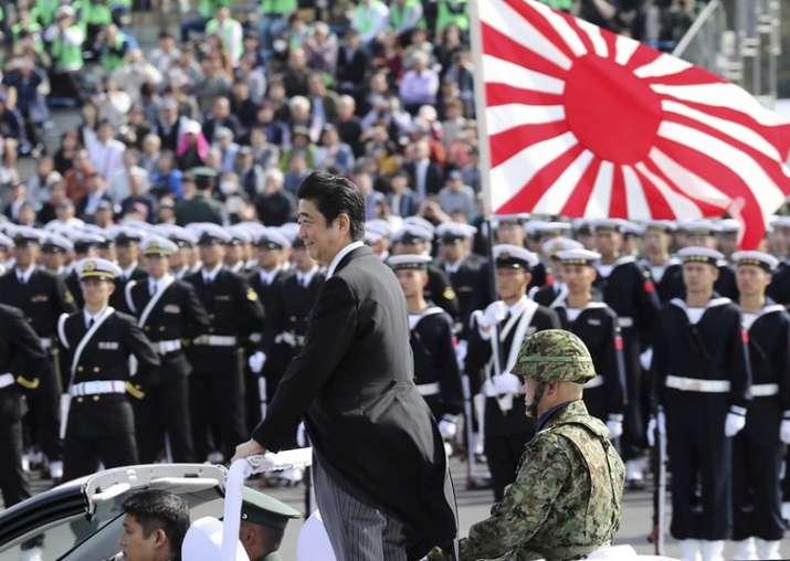 FILE - PM Shinzo Abe reviews members of Japan Self-Defense