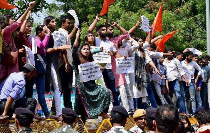 India Tv - ABVP members shout slogans during a protest in support of BHU students