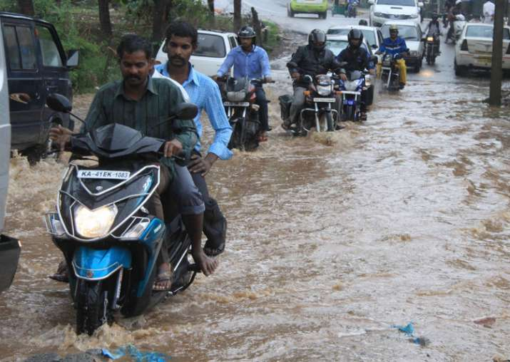 Motorists struggle through water logged streets of