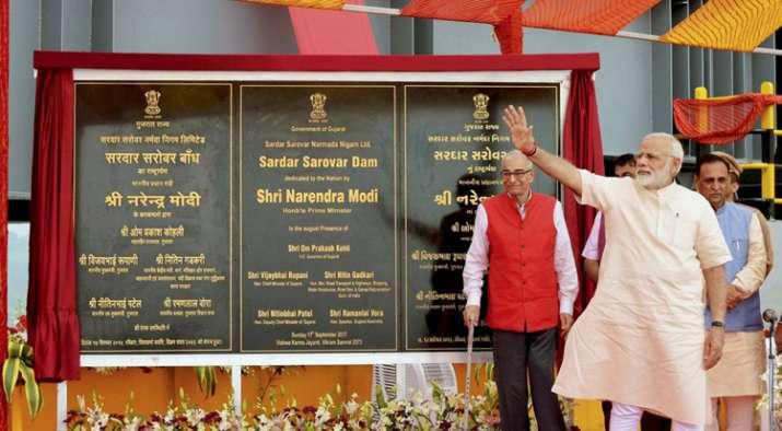 India Tv - PM Modi waves at gathering after inaugurating Sardar Sarovar Dam