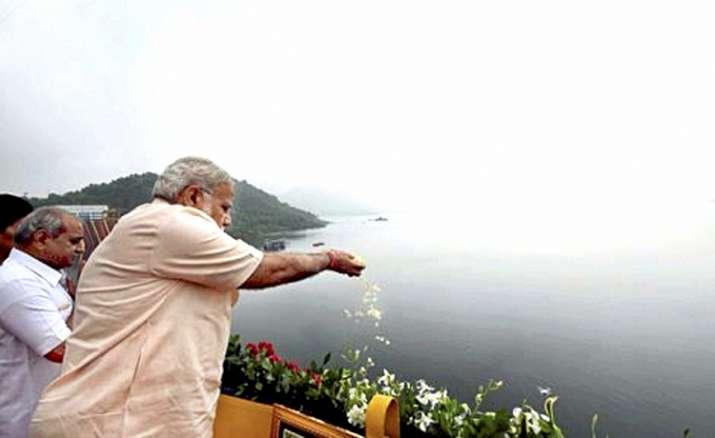 India Tv - PM offers prayers to Narmada River during inauguration of Sardar Sarovar Dam
