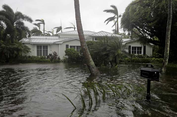 India Tv - A houses is surrounded by water as Hurricane Irma passes through Naples, Florida