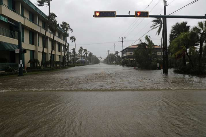 India Tv - Water floods a street in the business district in Naples, Florida