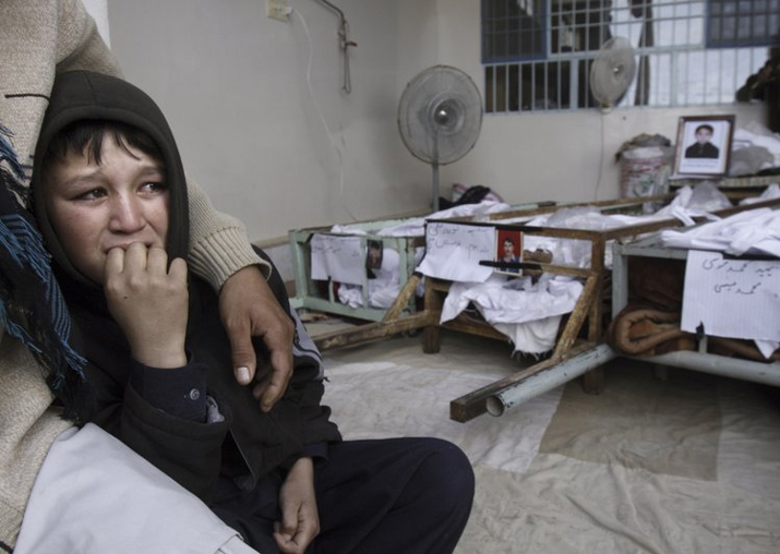 File - A Pak boy, whose brother was killed in bombing,