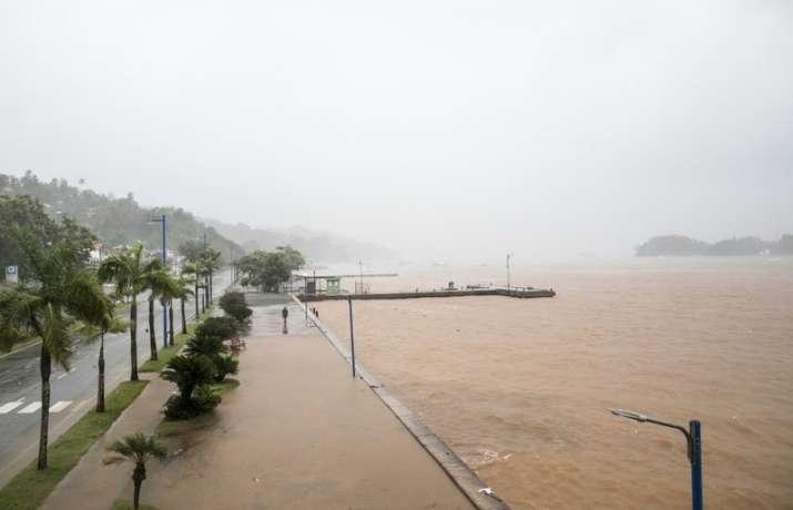 India Tv - Man walks by waterfront as Hurricane Irma approaches Samana, Dominican Republic